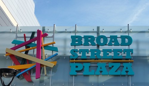 Bright candy colours in a sculptural built up layered sign design