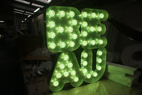 Colour changing LED cabochons in built up metal letters